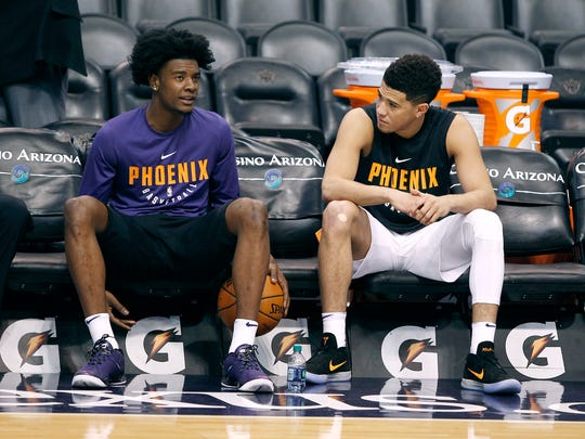 Phoenix Suns forward Josh Jackson, left, talks with teammate Devin Booker before a preseason game.