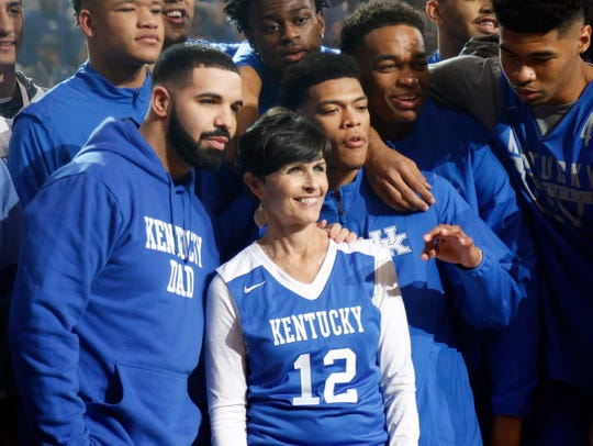 Ellen Calipari poses with Drake while surrounded by
