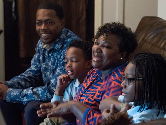 The Foster family, from left, Antone, Zion, Christy and Zay discuss the backpack food bag program at their home in Montgomery, Ala. on Tuesday November 28, 2017.