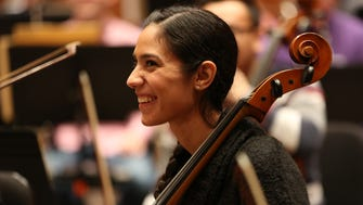 Local cellist Alina Vazquez smiles during a side by side play-along concert featuring community players and MSO orchestra members Tuesday night at the Marcus Center.