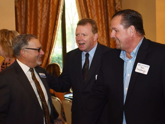 Barry Rothfeld, left, former publisher of the Poughkeepsie Journal, speaks with John Penney, center, the editorial page editor at the Poughkeepsie Journal, and Thomas Claybaugh, right, interim publisher of the Poughkeepsie Journal, at the United Way 2015 Campaign Kickoff Breakfast at the Poughkeepsie Grand Hotel.