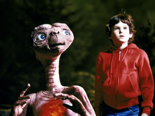 E.T. and Elliot, played by Henry Thomas, from the movie,