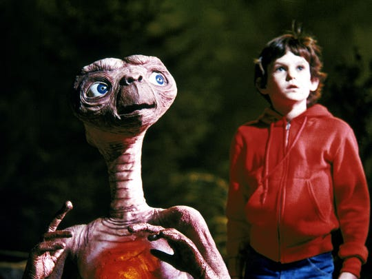 "E.T. and Elliot, played by Henry Thomas, from the movie, ""E.T. The Extra Terrestrial."" (Gannett News Service/Universal City Studios)"