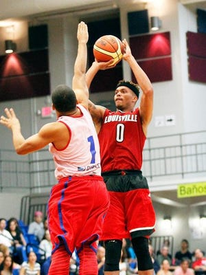Damion Lee shoots over the contested arms of a Puerto Rican defender.