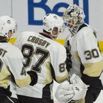 Pittsburgh Penguins center Sidney Crosby (87) congratulates goalie Matthew Murray (30) following their win against the Ottawa Senators at the Canadian Tire Centre.