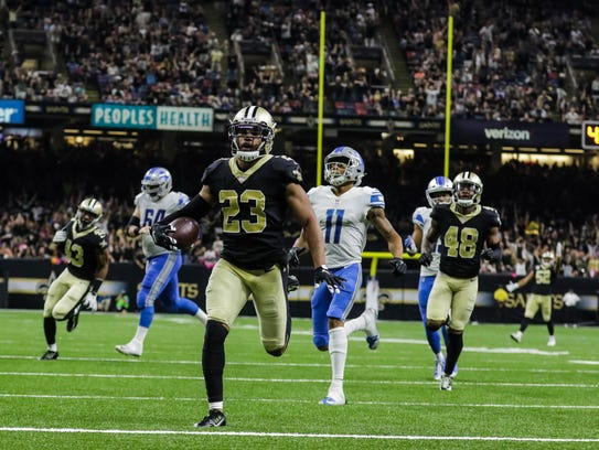 New Orleans Saints cornerback Marshon Lattimore (23) returns an interception for a touchdown against the Detroit Lions during the third quarter of a game at the Mercedes-Benz Superdome. The Saints defeated the Lions 52-38.
