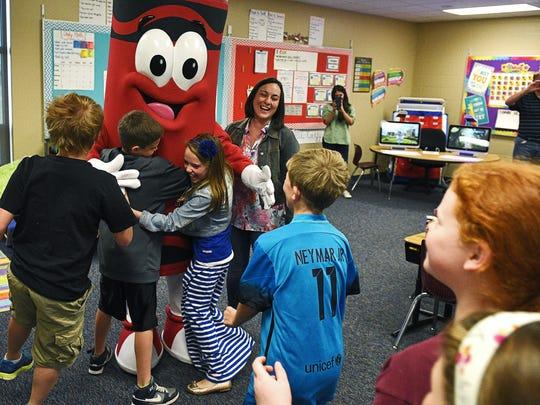 Razzmatazz, a Crayola Experience mascot, gets a group