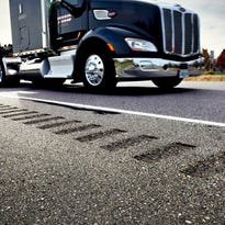 Traffic moves past rumble strips Tuesday on a section of Minnesota Highway 15 near St. Cloud. Stearns County may seek federal funding to install the strips along some county roads to increase safety.