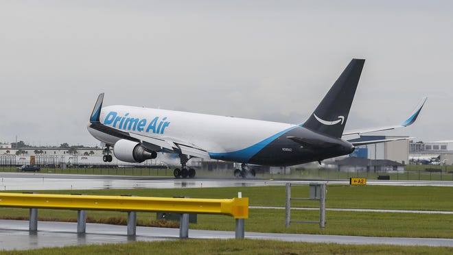 An Amazon Prime Air Boeing 767-300 touches down at the Amazon facility on Lakeland Linder International Airport. The airport has put in place the first in a series of measures it hopes will mitigate the noise complaints related to large, low-flying jets.