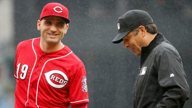 Cincinnati Reds first baseman Joey Votto (19), left, talks with umpire James Hoye (92), right, between innings during the MLB game between the Cincinnati Reds and the St. Louis Cardinals, Thursday, Aug. 6, 2015.