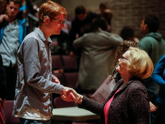 Sen. Claire McCaskill shakes hands with Jake Pinkston,