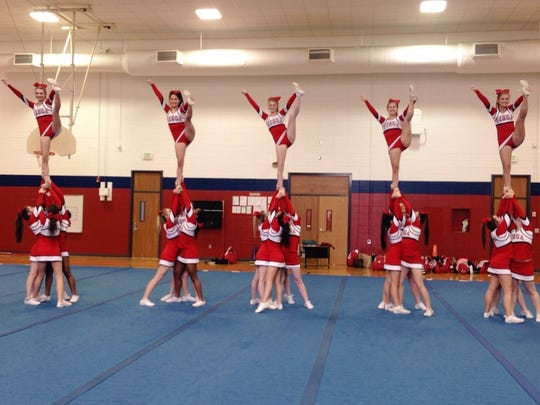 Tioga High School cheerleaders perform a heel stretch stunt from their competition routine. The squad placed second at nationals in Dallas, Texas, this month.
