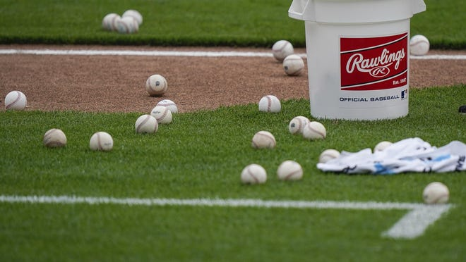 Baseballs wait to be gathered and sterilized during team baseball practice at Great American Ballpark on Wednesday in Cincinnati.