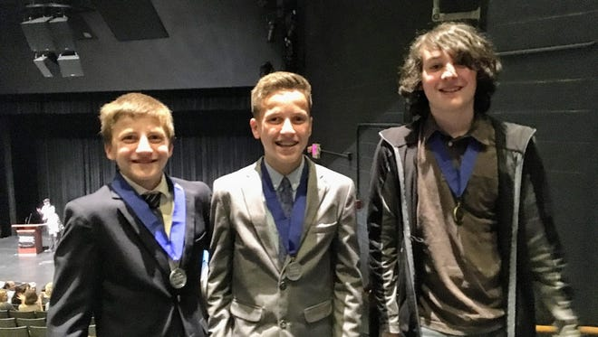 Left to right are 8th grade students Joseph Avallone, Jacob El-Zahr, and Andrew Ranallo with their NJ History Day medals!
