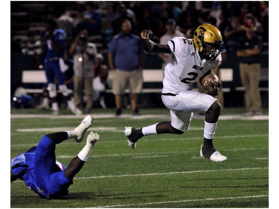 Abilene High School's Niyungeko Moise leaps over a