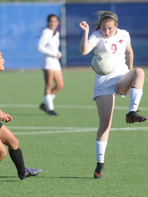 Cooper's Honna Turner, right, gets her foot on the ball as an Amarillo Caprock player looks on. Cooper beat Caprock 1-0 in the Region I-5A bi-district playoff game Friday, March 30, 2018 at the Frenship Soccer Complex in Wolfforth.