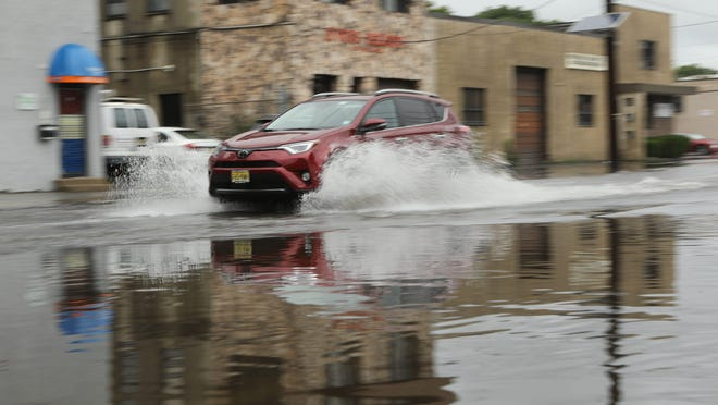A vehicle is shown on Hudson St. in Hackensack after July 18, 2019 heavy rains.