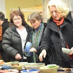People help themselves to food last year at the Empty Bowl Benefit in Middlesex. This year's benefit for the Vermont Foodbank will be Feb. 13