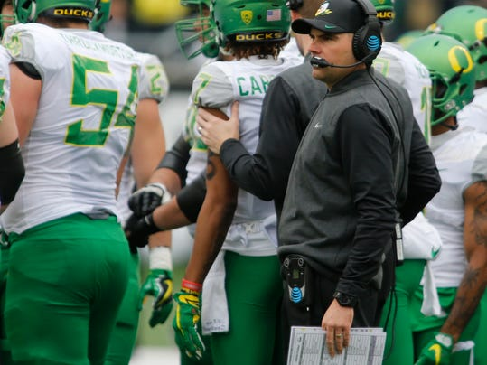 FILE- In this Nov. 26, 2016, file photo, Oregon head coach Mark Helfrich looks on in the first half an NCAA college football game against Oregon State, in Corvallis, Ore. Oregon's 34-24 loss to the Oregon State Beavers in the 120th Civil War has thrown coach Mark Helfrich's future with the team in doubt, as well as the direction of the program. Just moments after the Ducks left the field at Oregon State, Helfrich was asked about his job security. (AP Photo/Timothy J. Gonzalez, file)