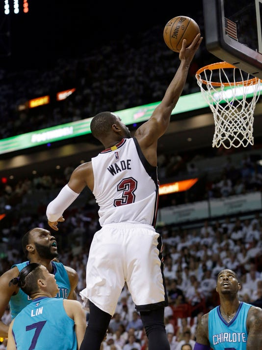 Miami Heat guard Dwyane Wade (3) goes to the basket against the Charlotte Hornets during the first half of Game 2 of a first-round NBA basketball playoff series, Wednesday, April 20, 2016, in Miami. (AP Photo/Alan Diaz)