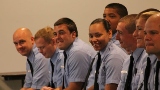 Alissa Turner prepares to graduate from the Rochester Fire Academy alongside her fellow recruits.