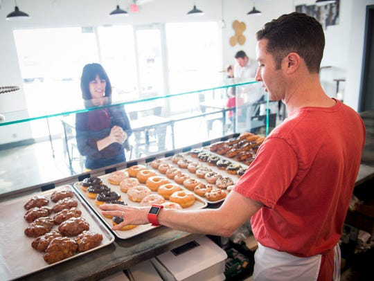 Co-owner Jimmy Wooten describes the different doughnuts