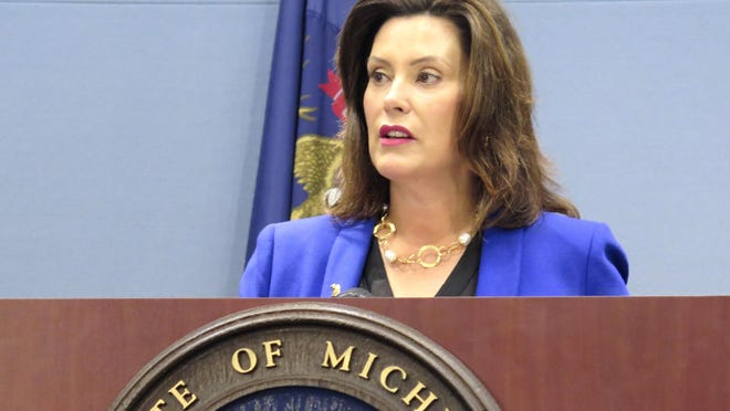 FILE - In this Aug. 28, 2019 file photo, Michigan Gov. Gretchen Whitmer speaks at a news conference in Lansing, Mich. Whitmer has signed changes to Michigan's reporting requirements for people who will have to meet work-related requirements to qualify for Medicaid coverage. But she's criticizing the Republican-led Legislature for not allocating $10 million to implement the rules. Whitmer on Monday, Sept. 23, 2019, signed a law exempting some enrollees in the state's Medicaid expansion program from meeting monthly reporting rules if the state can verify their compliance with work requirements through other data.