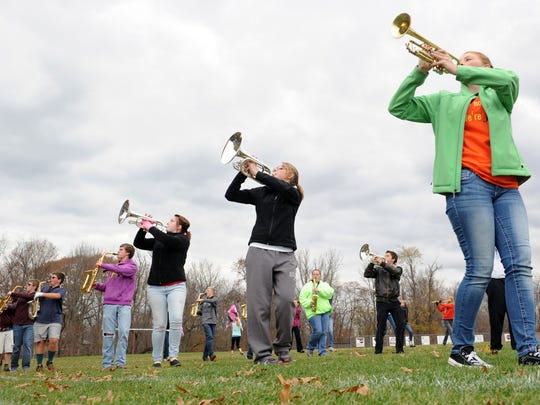 The John Glenn High School marching band practices outside Oct. 30 at John Glenn High School in New Concord. The band will compete in the state marching band competition this year.