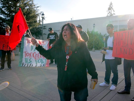 Olga Reyna of the United Farmworkers protests for immigrant