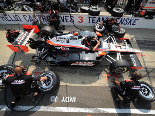 Team Penske's Helio Castroneves crew works on their pit stops before the beginning of Carb Day, 2010 at the Indianapolis Motor Speedway.
