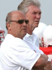 In 1990, Pat Richter (right) changed the direction of the Wisconsin football program when he hired Barry Alvarez (left) as the new coach.