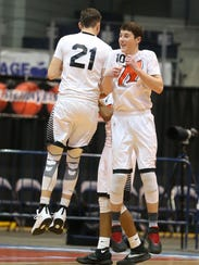 Northstar's Matthew Medeiros, right, gives a leaping shoulder bump with teammate Daniel Pickett during player introductions before their Section V Class C1 final at the Blue Cross Arena at the War Memorial on Feb. 5.