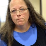 Rowan County Clerk Kim Davis listens to a customer Sept. 1, 2015, after her office refusal to issue marriage licenses in Morehead, Ky.