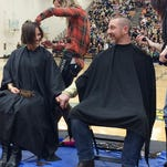 Last year, Principal Jason Schrock and his wife, Hollie, shaved their heads for cancer research. They will not be doing that again this year.