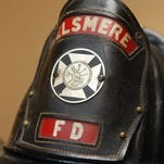 """KYXXHEROESOFFIRE KY JULY 24, 2008 Detail photo of an Elsmere Fire Department  captain's helmet from the 1950's or 1960's which is among the items on display in the  """"Heroes of Fire/EMS"""" exhibit   at the Behringer-Crawford Museum, Devou Park, Covington.  The exhibit, which runs from 7/26/08-10/26/08, features historical items including clothing, helmets, breathing apparatus and hose nozzles.  The exhibit coincides with  the Kentucky Firefighter's Association's 2008 Annual Conference in August at the Drawbridge Inn, Fort Mitchell.  Siegrist's father, Richard Siegrist, is a retired Covington firefighter.  The Enquirer/Patrick Reddy"""