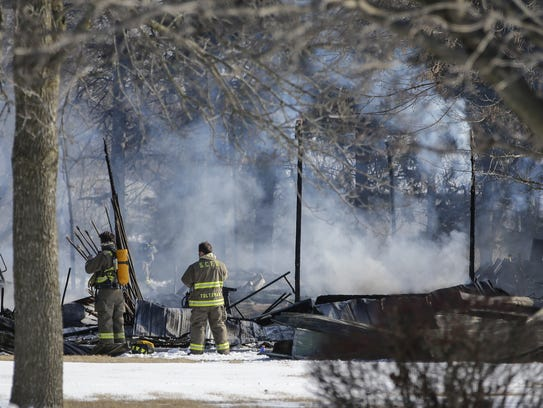 Silver Creek firefighters survey the damage after a