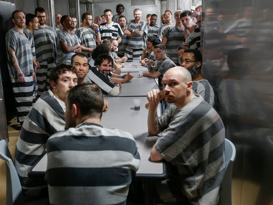Inmates congregate in the common area of the new trailer