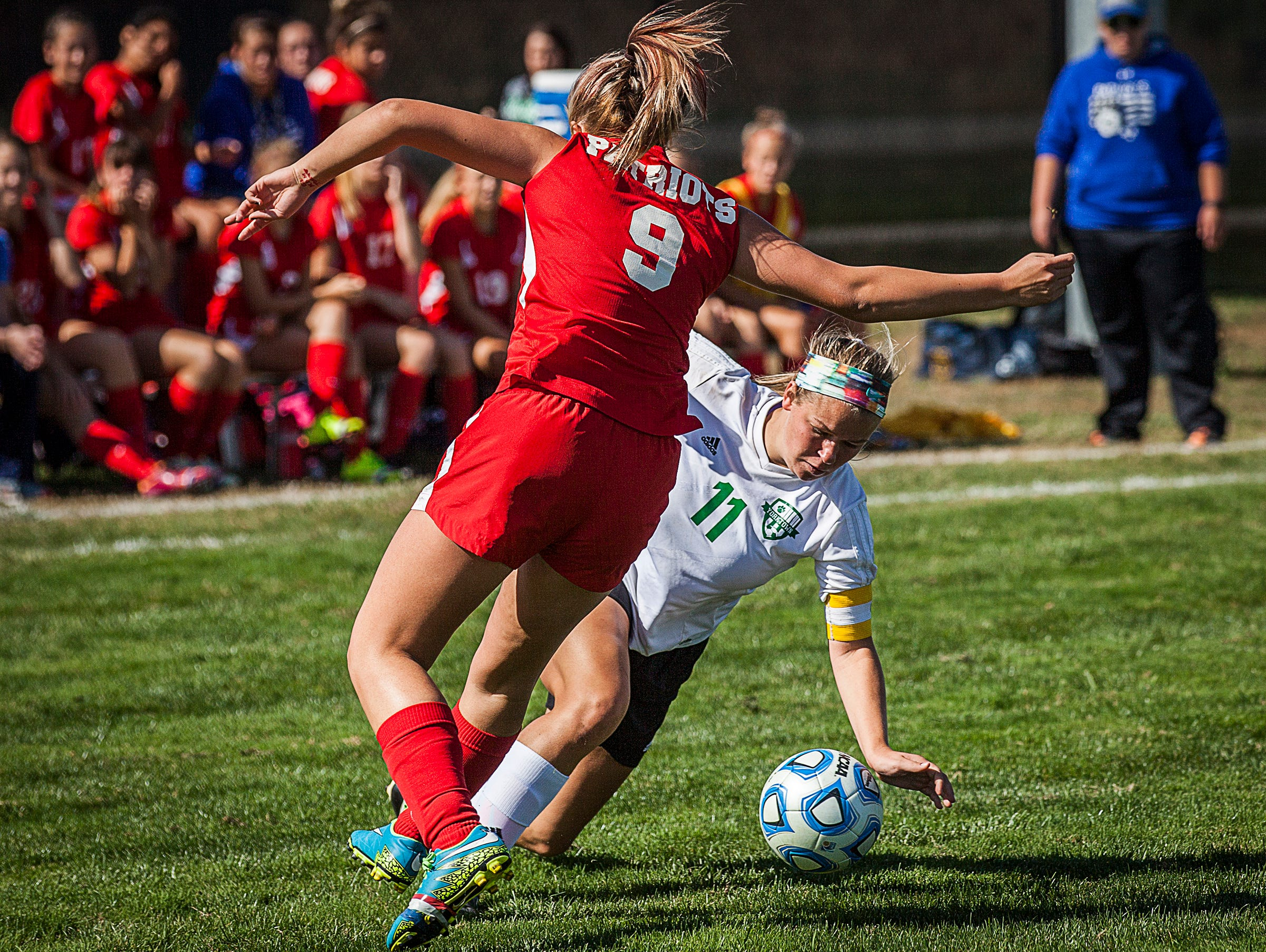 Yorktown's Katie Nixon fights past Jay County's defense during their game at the Yorktown Sports Park on Saturday, Oct. 10, 2015.