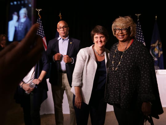 Anne Holton, wife of vice presidential candidate Tim Kaine, left,  poses for a photo with Laverne Williams of Detroit  following panel  discussion about the importance of voter registration and  other topics at Little Rock Baptist Church in Detroit on Monday, Sept. 27, 2016.