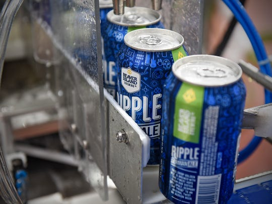 Cans of Ripple roll off the new canning line May 24, 2017 at Beaver Island Brewing Co. in St. Cloud.