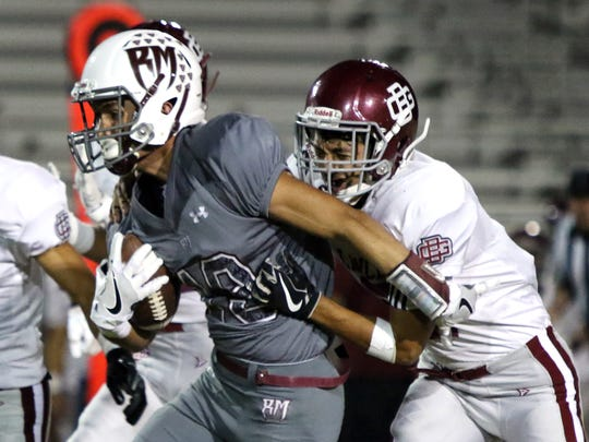 Rancho Mirage's Julius Hernandez runs the ball against Bell Gardens' Brandon Ponce during the first half of the game in Rancho Mirage on Friday, September 29, 2017.
