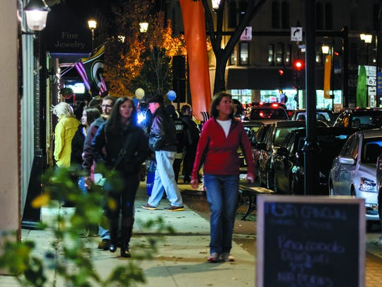 Art lovers flock to downtown Oconomowoc for a past Fall Gallery Night. This year's event will run from 5 to 9 p.m. Saturday, Nov. 4.