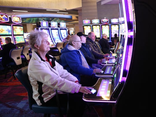 Guests play the slot machines at Resorts World Catskill Casino in Monticello in February.