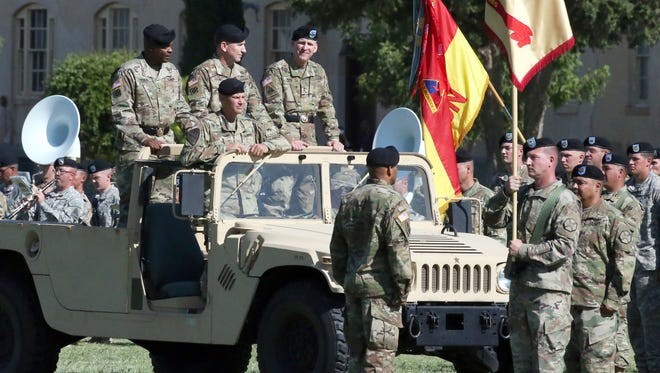 """Maj. Gen. Robert """"Pat"""" White, right, rides along with Gen. Robert B. Abrams, center, and Maj. Gen. Stephen M. Twitty, left, during an inspection of troops at a change of command ceremony for the 1st Armored Division and Fort Bliss Wednesday on post. White assumed command from Twitty at the ceremony. Riding with the generals is Col. Charles Constanza, chief of staff for the 1st Armored Division."""