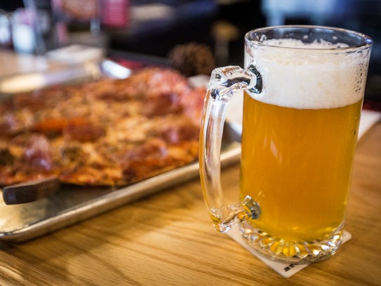 Pizza and beer are among the specialties at Thr3e Wise