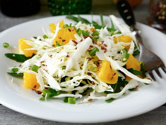Easy cabbage salad with arugula and orange