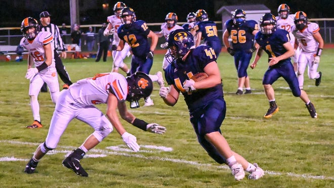 Hillsdale's Brody Young (44) carries the football during Friday's season opener against Hudson at Baumgarten Stadium. Sam Fry/Daily News