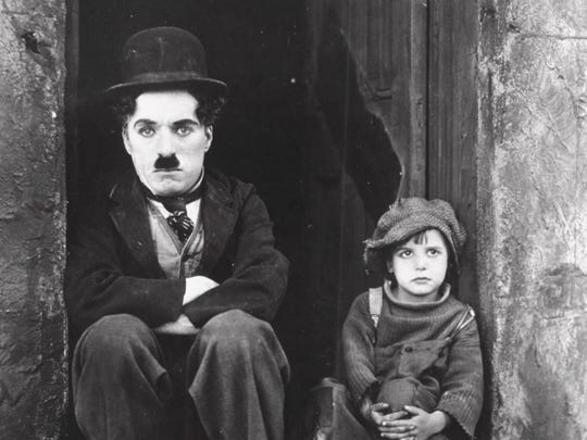 Charlie Chaplin, left, and Jackie Coogan appear in a scene from Chaplin's 1921 silent film, 'The Kid.'