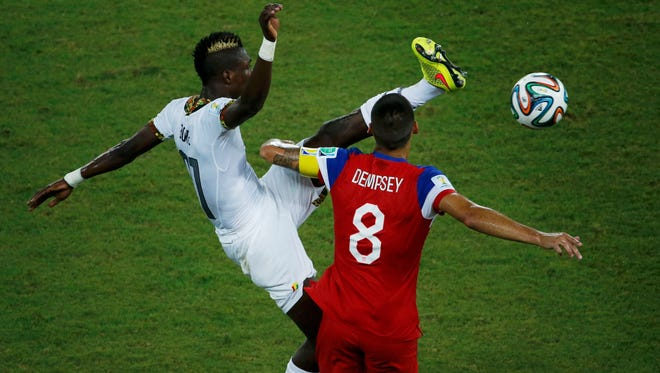 Ghana's John Boye, left, kicks high and knocks into the face of Clint Dempsey of the U.S. during their World Cup match Monday.