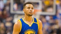 Golden State Warriors guard Stephen Curry looks on